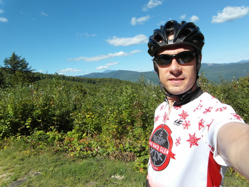 Steve on Bear Notch Road with Mount Washington in the Background